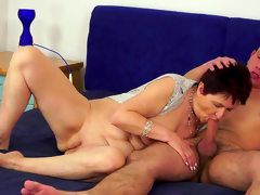 Mature whore rides thick shaft after..