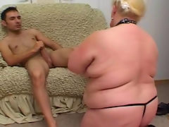 Fat blonde slave gets face fucked by..