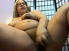 Big blonde woman masturbates