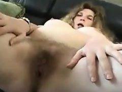Fat mother rubbing her pussy