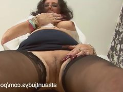 Zadi rubs and fingers her pussy in the..