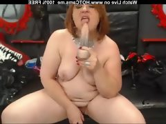 Chubby mature redhead playing with dildo