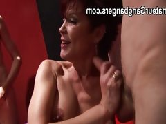 Mature redhead takes two cocks