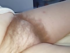 Close up of her long soft pussy pubes,..