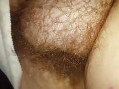Closeup of her long soft hairy pussy,..